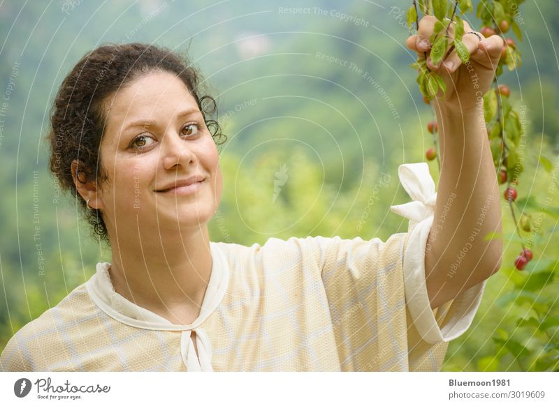 Portrait of a happy young woman holding a plum branches Woman Human being Nature Youth (Young adults) Healthy Eating Young woman Summer Colour Beautiful Green