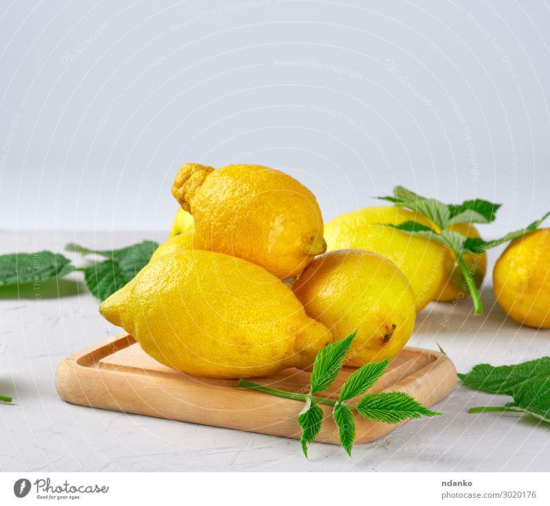 fresh ripe whole yellow lemons Fruit Vegetarian diet Diet Lemonade Juice Summer Table Nature Leaf Wood Eating Fresh Natural Juicy Yellow Green White Colour