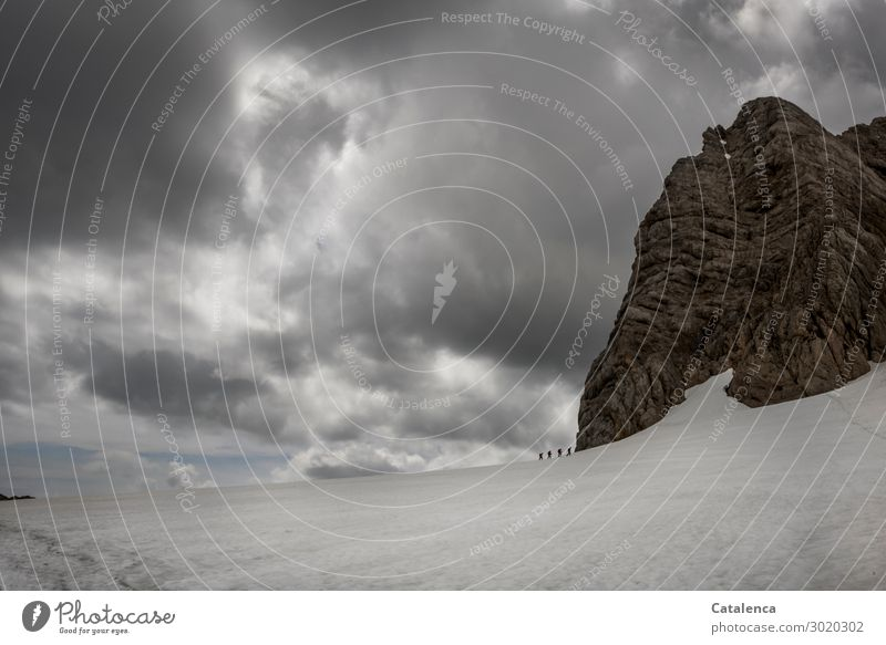 Airy| Glacier Hike Mountain Hiking Group Nature Landscape Sky Storm clouds Horizon Bad weather Snow Alps Movement Going Threat Authentic Tall Cold Brown Gray