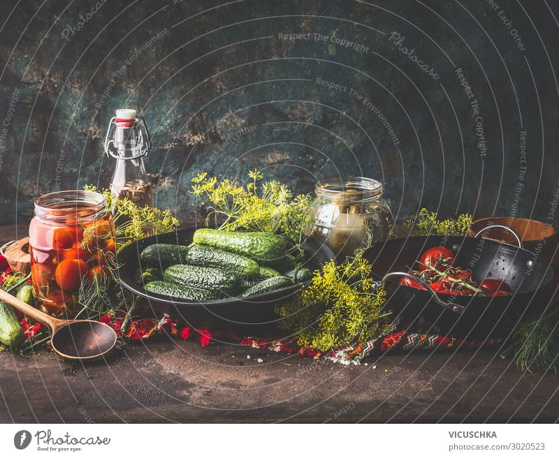 Pickling cucumbers and tomatoes in glasses Food Vegetable Herbs and spices Nutrition Organic produce Vegetarian diet Diet Crockery Glass Shopping Style