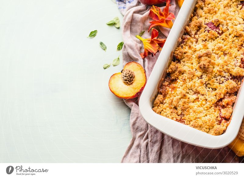 Yummy peach crumble dessert in baking pan on light background , top view. Copy space for your design or recipe yummy copy space plate cooking copyspace prepared
