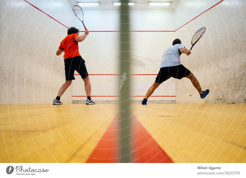 Two friends playing squash in Mutilva, Navarra, Spain Joy Relaxation Leisure and hobbies Playing Sports Closing time Woman Adults Man Friendship Breathe