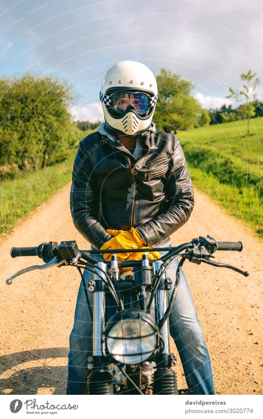 Man with helmet riding custom motorbike Lifestyle Engines Human being Adults Grass Transport Street Lanes & trails Vehicle Motorcycle Fashion Jeans Gloves Sit