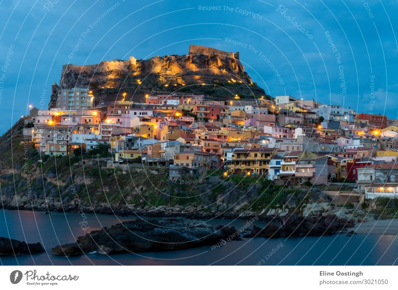 Beautiful panoramic view of Medieval town of Castelsardo at evening (night), Province of Sassari, Sardinia, Italy, Europe. Colorful photo of gorgeous italian town. Popular travel destination.