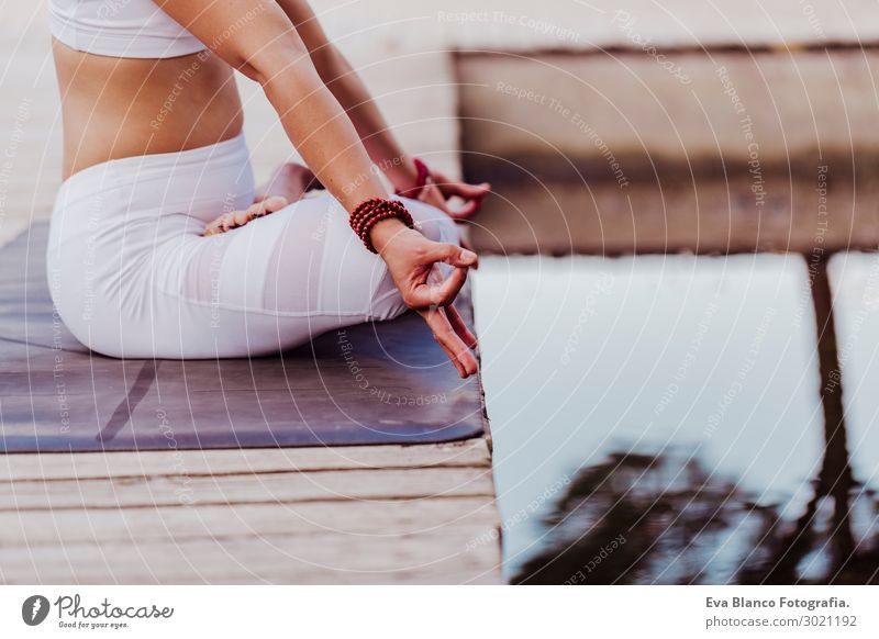 unrecognizable young asian woman doing yoga in a park.Relax Woman Human being Nature Youth (Young adults) Young woman Summer Beautiful White Landscape