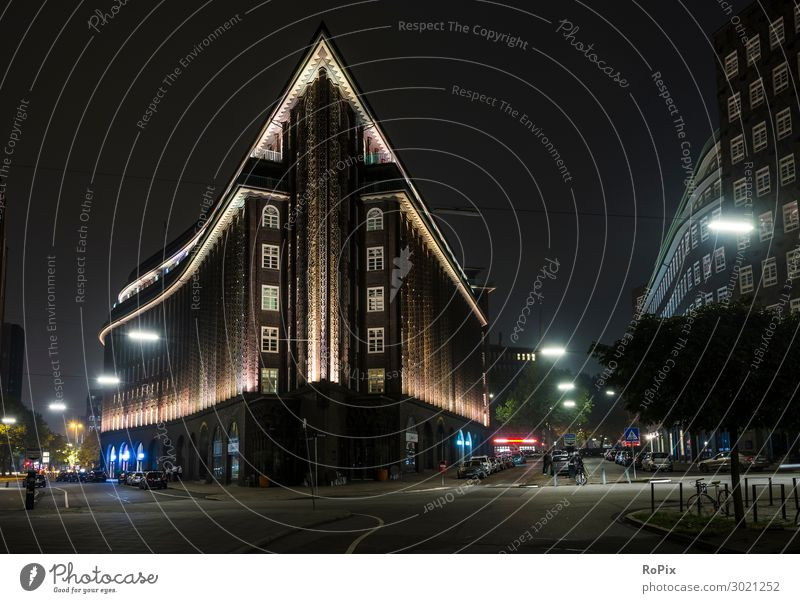 Chilehaus in Hamburg at night. Style Design Tourism Trip Sightseeing City trip Office work Workplace Economy Trade Museum Sculpture Architecture Environment