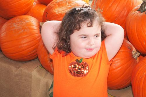 Child in the Pumpkin Patch Human being Girl Face Autumn Feminine Hair and hairstyles Orange Contentment Smiling Infancy Happiness Clothing Cute T-shirt Event
