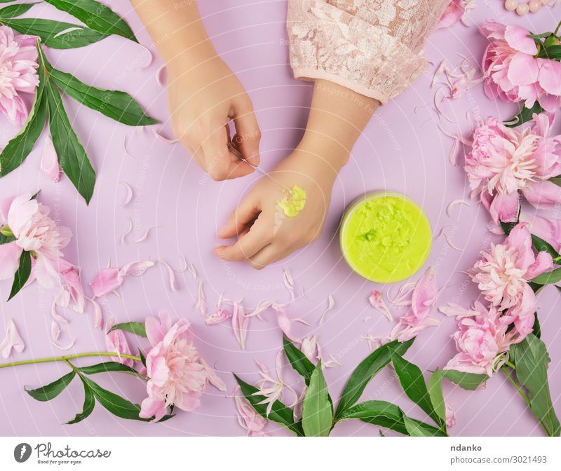 female hands and a jar with thick green scrub Woman Summer Plant Green Hand Flower Leaf Adults Natural Fashion Pink Above Body Fresh Skin Fingers