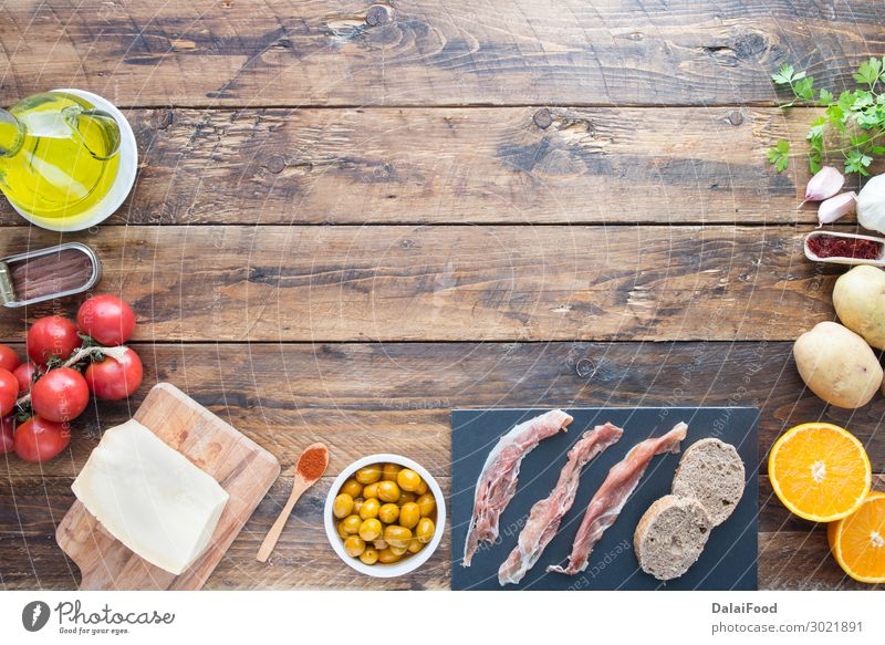 typical ingredients of spain Meat Cheese Vegetable Bread Dinner Table Wood Fresh Delicious Green Red Black Tradition anchovies azafran background board cooking
