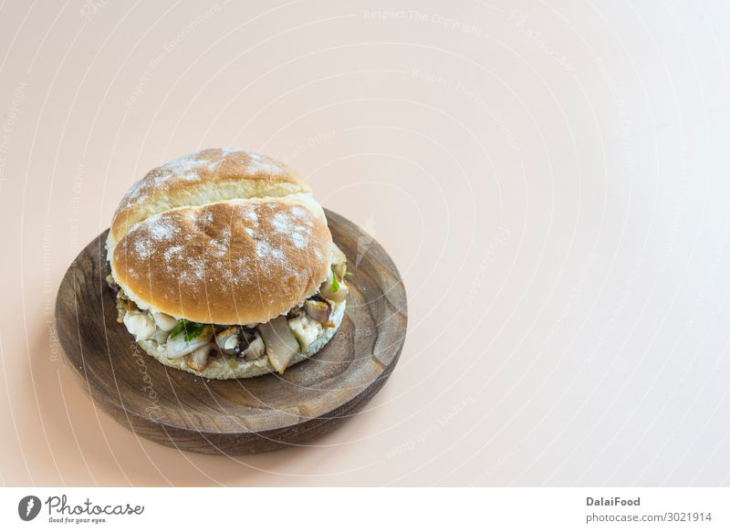 Sandwich of fish typical spanish Meat Seafood Cheese Vegetable Bread Roll Lunch Wood Fresh Delicious Green Red White background board breaded burger crispy