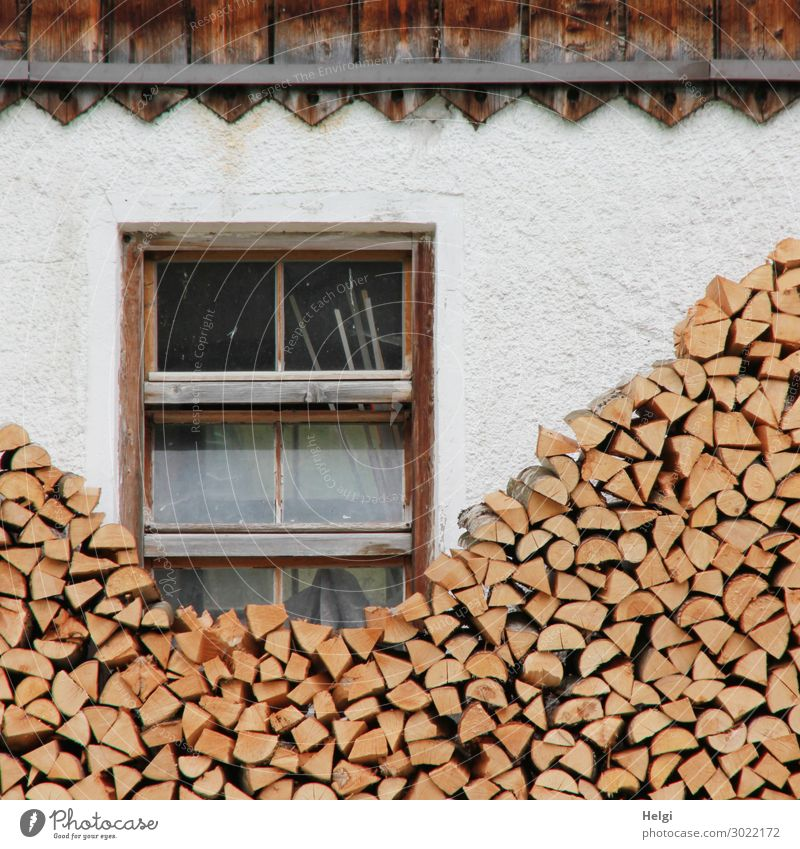 Facade of a house with windows and a lot of stacked firewood House (Residential Structure) Wall (barrier) Wall (building) Window Stack of wood Stone Wood Lie