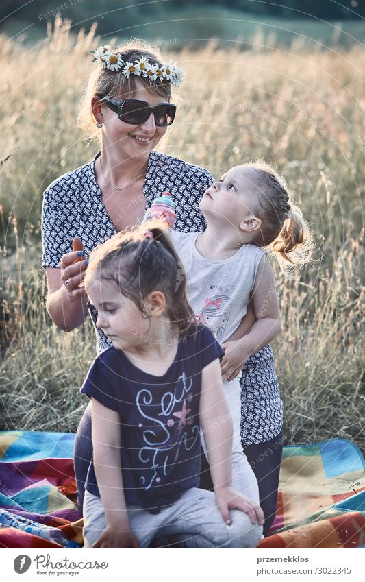 Family spending time together on a meadow Woman Child Human being Vacation & Travel Nature Summer Beautiful Green Landscape Flower Relaxation Calm Joy Girl