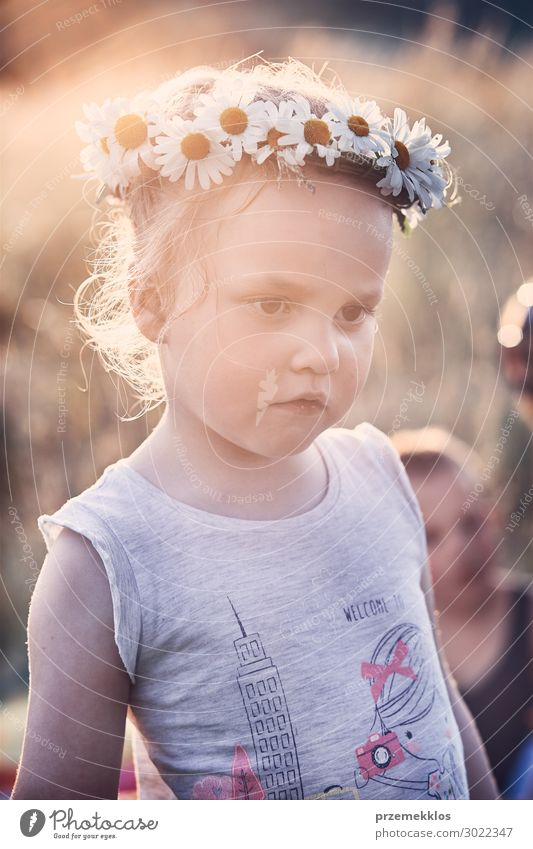 Little girl wearing a coronet of wild flowers on her head Child Human being Vacation & Travel Nature Summer Beautiful Green Landscape Flower Relaxation Calm Joy