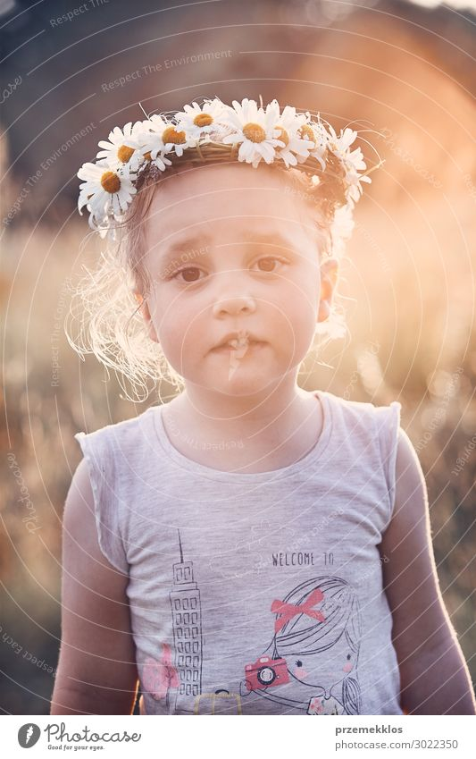 Little girl wearing a coronet of wild flowers on her head Lifestyle Joy Happy Relaxation Leisure and hobbies Playing Vacation & Travel Summer Child Human being