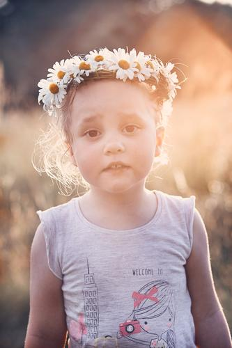 Little girl wearing a coronet of wild flowers on her head Child Human being Vacation & Travel Nature Summer Green Landscape Flower Relaxation Calm Joy Girl
