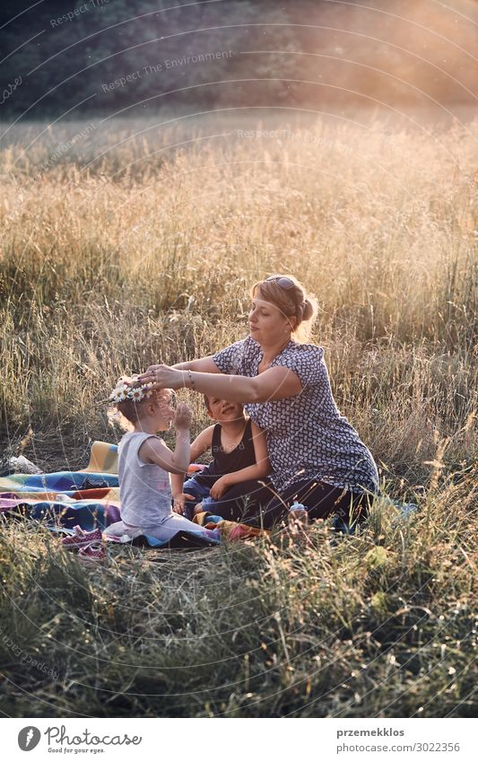 Family spending time together on a meadow Woman Child Human being Vacation & Travel Nature Youth (Young adults) Young woman Summer Green Landscape Flower