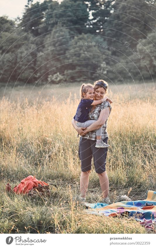 Family spending time together on a meadow Lifestyle Joy Happy Relaxation Leisure and hobbies Vacation & Travel Summer Summer vacation Child Human being Girl