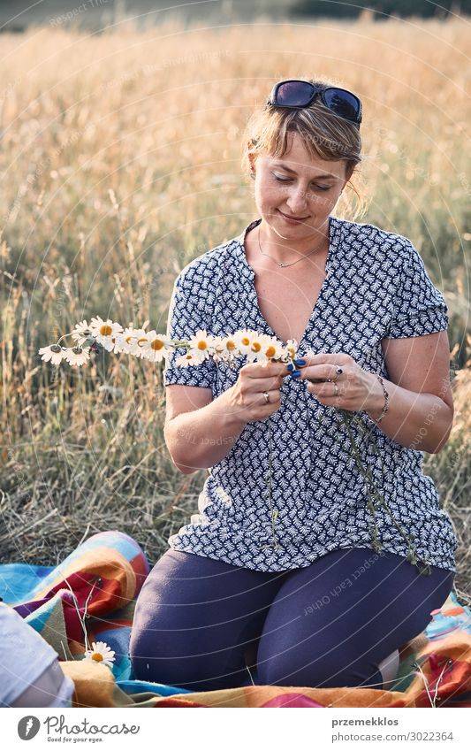 Woman making coronet of wild flowers Child Human being Vacation & Travel Nature Youth (Young adults) Young woman Summer Green Landscape Flower Relaxation Joy
