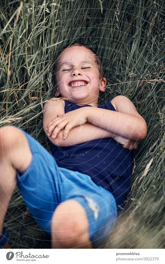 Little happy smiling boy playing in a tall grass Child Human being Vacation & Travel Nature Summer Green Landscape Relaxation Joy Lifestyle Environment Natural