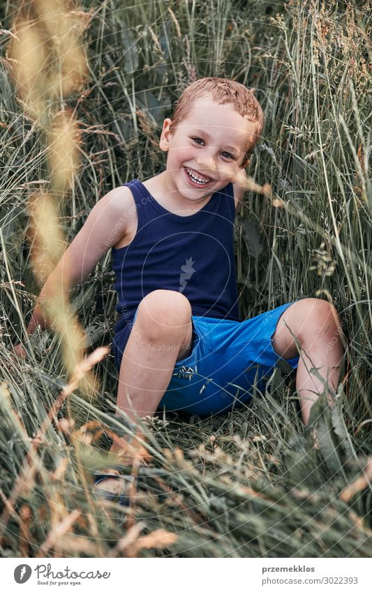 Little happy smiling kids playing in a tall grass Lifestyle Joy Happy Relaxation Vacation & Travel Summer Summer vacation Child Human being Boy (child) 1