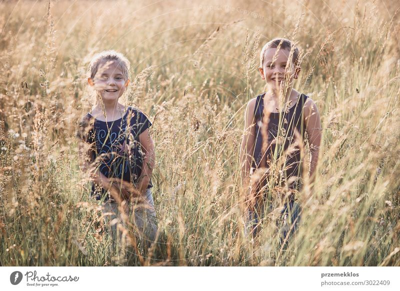 Little happy smiling kids playing in a tall grass Lifestyle Joy Happy Relaxation Vacation & Travel Summer Summer vacation Child Human being Girl Boy (child)