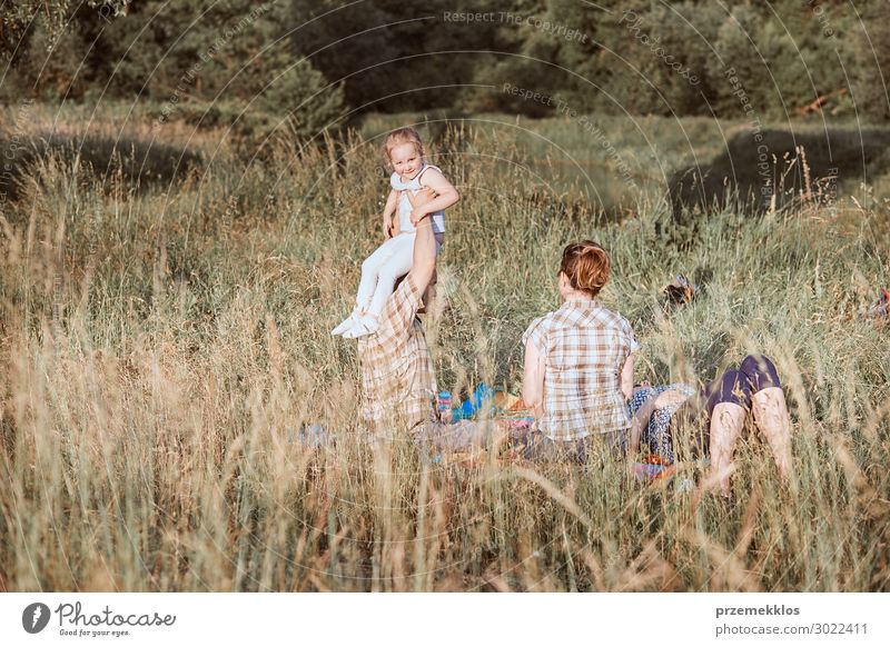 Family spending time together on a meadow Woman Child Human being Vacation & Travel Nature Man Summer Green Landscape Relaxation Joy Girl Lifestyle Adults