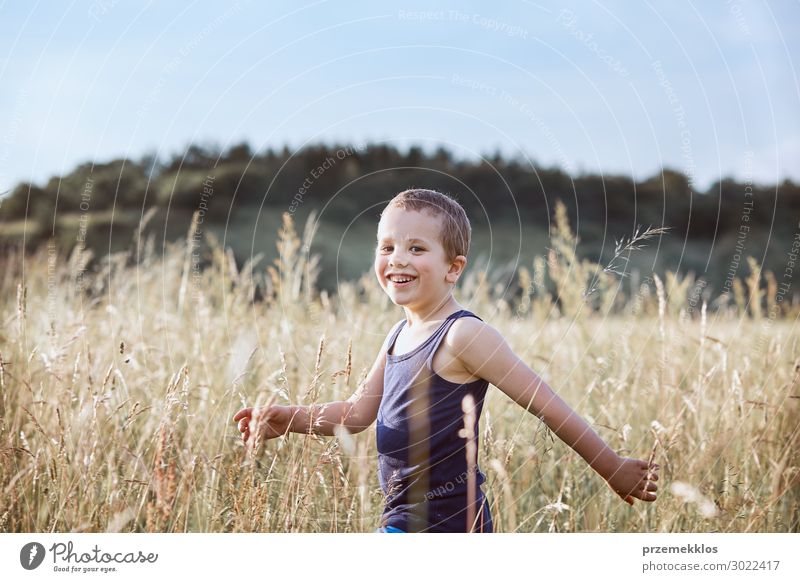Little happy boy walking through a tall grass in the countryside Child Human being Vacation & Travel Nature Summer Green Landscape Relaxation Joy Lifestyle