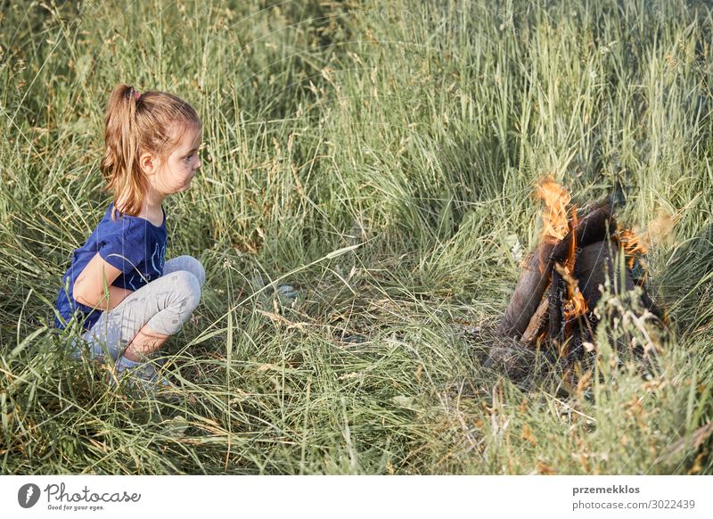 Little girl looking at campfire sitting in a grass Woman Child Human being Vacation & Travel Nature Summer Green Landscape Relaxation Joy Girl Lifestyle Adults