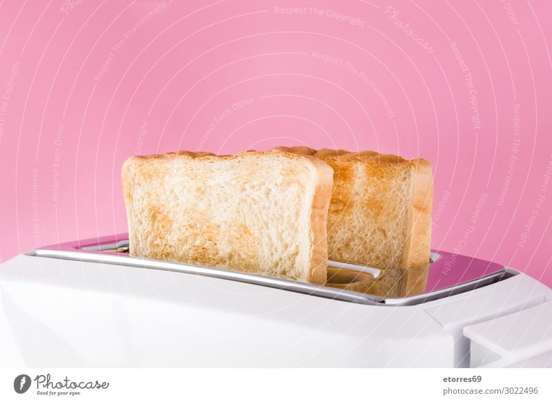 Toasted toast bread in white toaster on pink background. Bread Ready Toaster White isolated Food Healthy Eating Food photograph Breakfast Sandwich Close-up