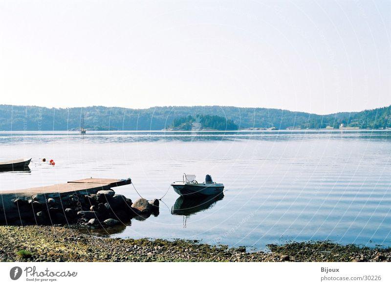 The lake rests still Watercraft Lake Footbridge Calm Loneliness Scandinavia Fjord Sweden Coast