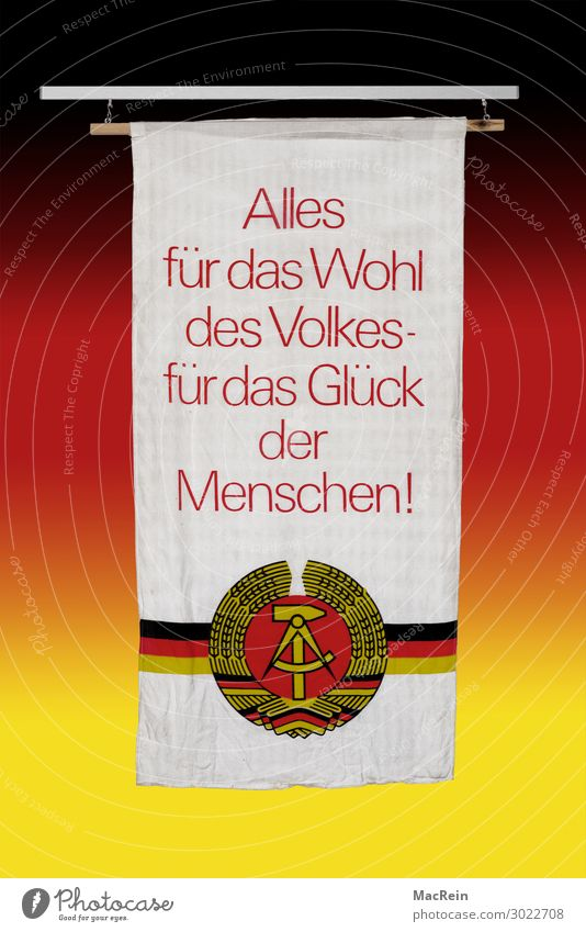 40th anniversary of the GDR Hammer Flag Old Slogan Background picture Germany Symbols and metaphors Text Coat of arms Figure of speech Crescent moon