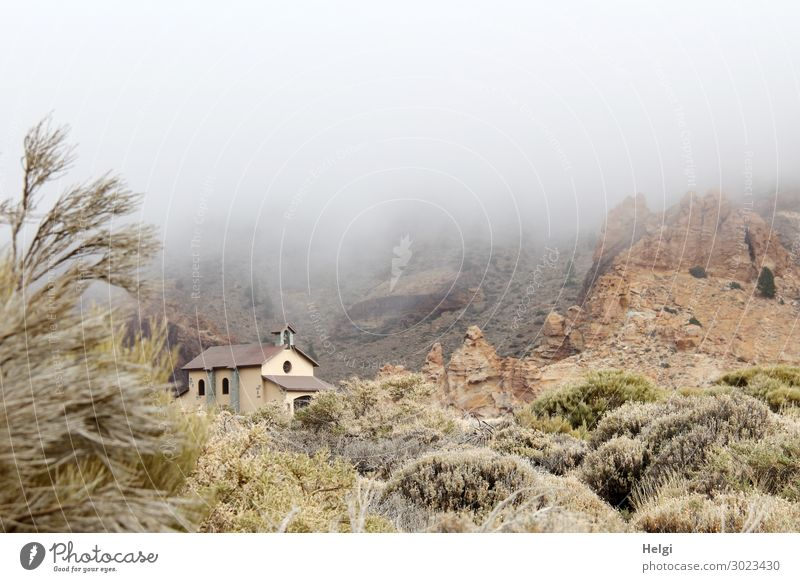 small church in the National Park Teide on Tenerife, in the middle of a bizarre landscape with plants and clouds of fog Vacation & Travel Tourism Trip