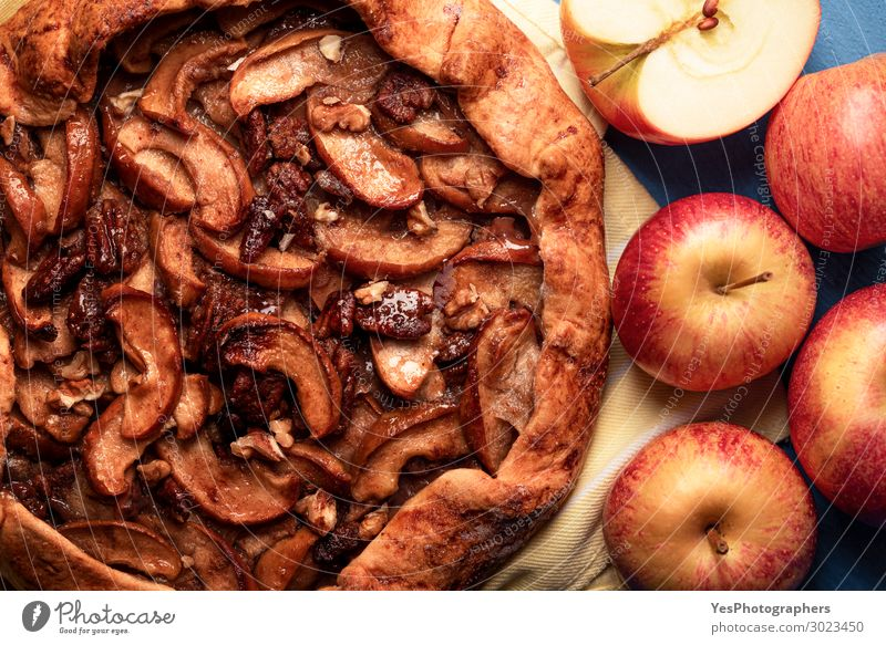 Homemade apple pie with pecan nuts. Autumn dessert Food Apple Cake Dessert Warmth Fresh Delicious Many Gold Tradition Thanksgiving day above view Apple pie