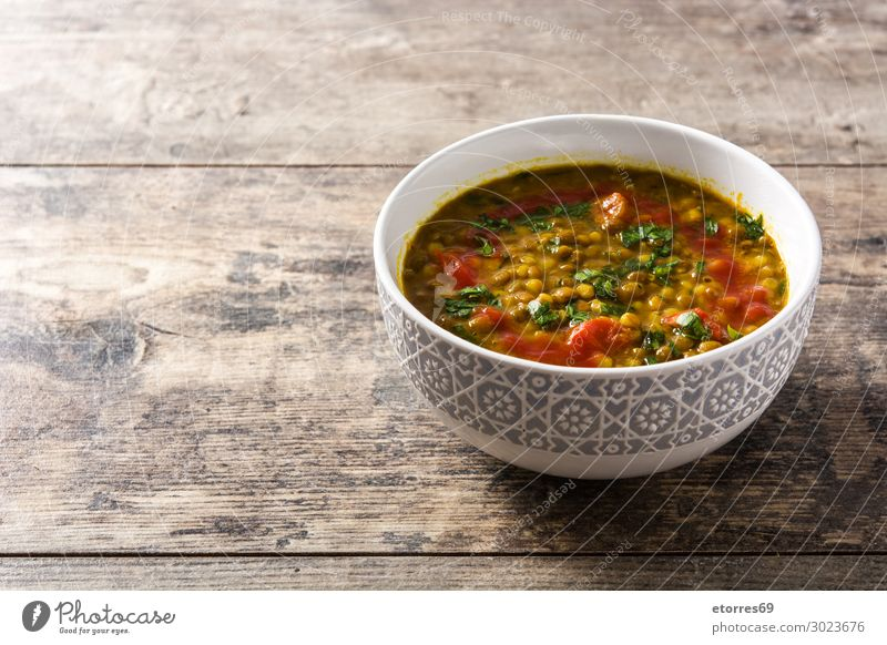 Indian lentil soup dal (dhal) in a bowl on wooden table Lentils Soup Bowl Yellow Food Healthy Eating Food photograph Tradition Spicy diwali Home-made isolated