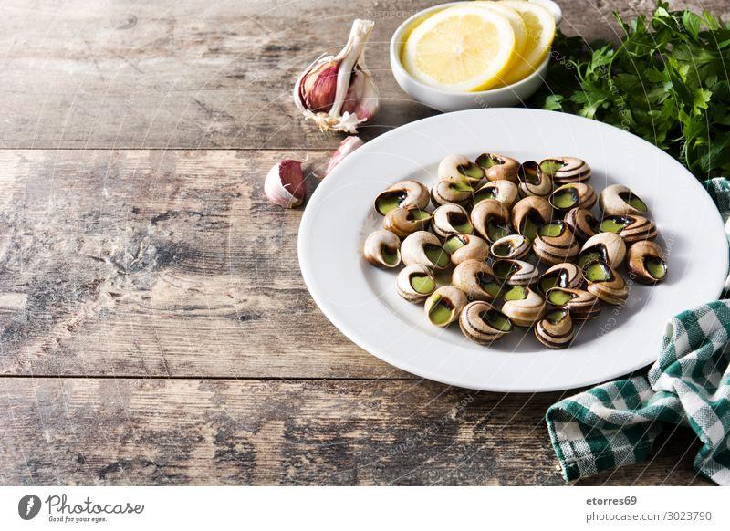 Escargots de Bourgogne on wooden table Burgundy Cooking Diet Dinner eat escargots escargots de bourgogne Food Healthy Eating Food photograph French Fresh Garlic