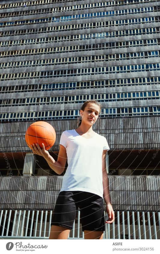 Young female basketball player in an urban court Lifestyle Beautiful Playing Sports Woman Adults Youth (Young adults) Park High-rise Street Tall Cute girl