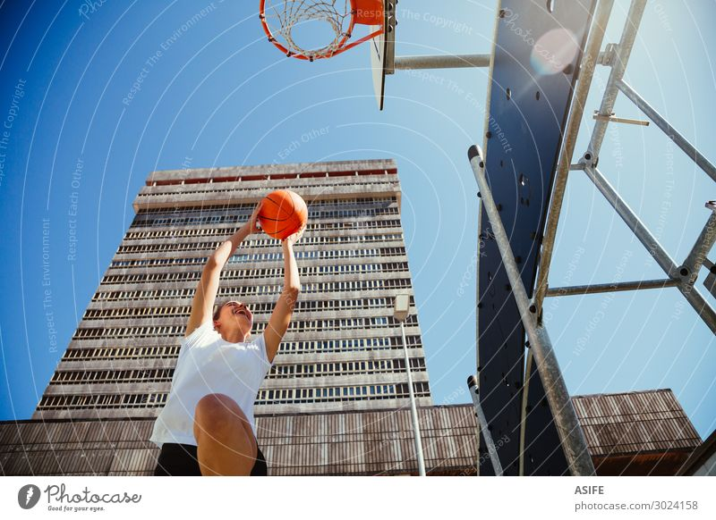 Girl playing basketball outdoors in the city Woman Sky Youth (Young adults) Summer Beautiful Joy Street Lifestyle Adults Sports Building Playing Jump Park