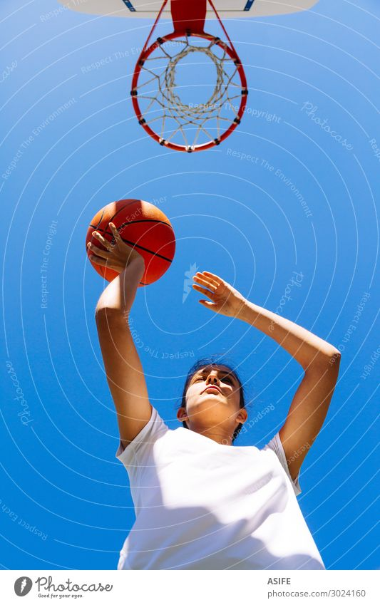 Girl playing basketball in a sunny day Lifestyle Joy Beautiful Playing Summer Sports Woman Adults Youth (Young adults) Sky Park Jump Cute Competition girl