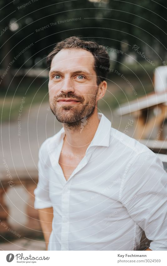 handsome man in white shirt looking up attractive beard bearded caucasian cheerful confident friendly guy happiness happy lifestyle male masculine outdoor