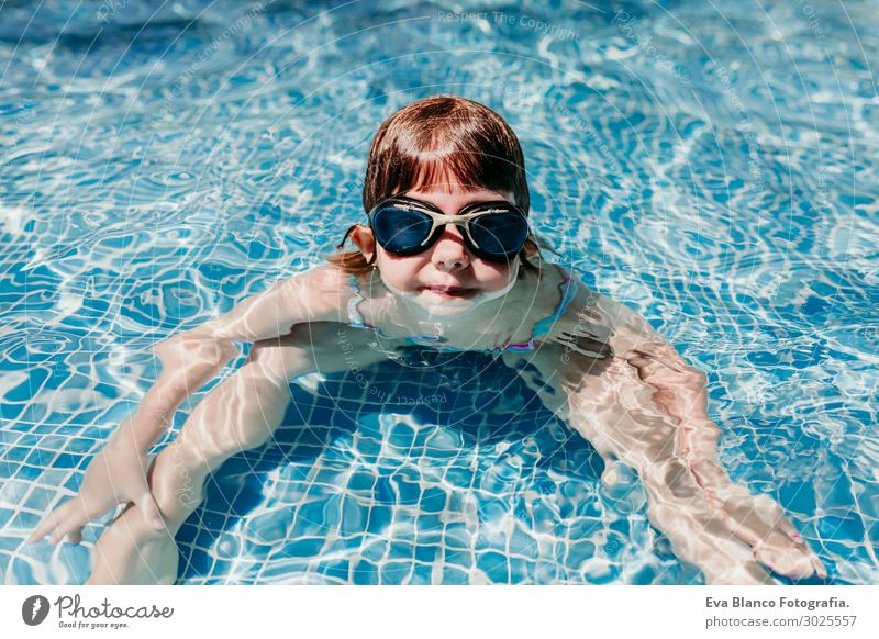 beautiful kid girl at the pool diving with water goggles.Summer Joy Swimming pool Leisure and hobbies Playing Vacation & Travel Sports Dive Child Human being