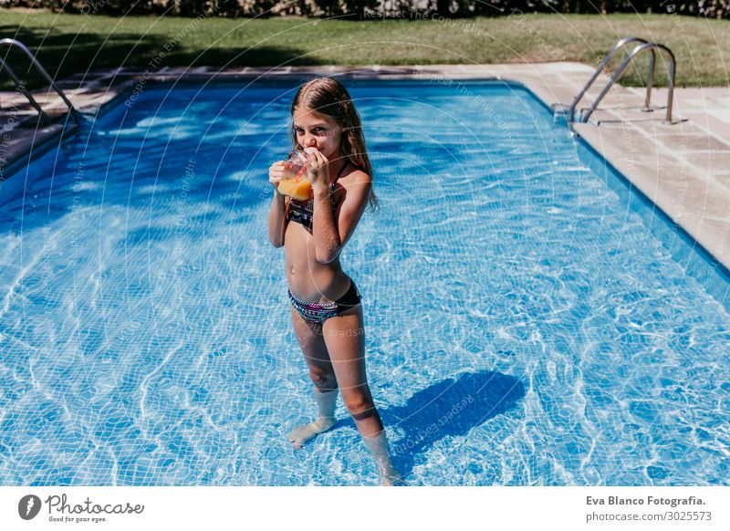 beautiful teenager girl at the pool drinking orange juice Drinking Juice Lifestyle Joy Swimming pool Playing Vacation & Travel Summer Sun Sports Dive Child