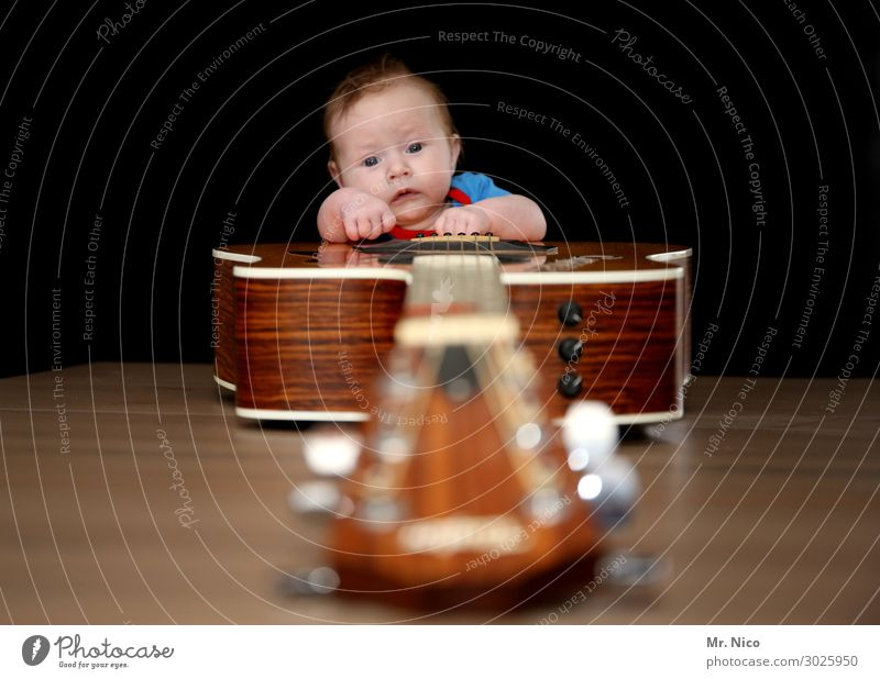 Rock 'n' Roll Junior Leisure and hobbies Music Human being Baby 1 0 - 12 months Listen to music Musician Guitar Listening Guitarist Guitar neck Guitar string