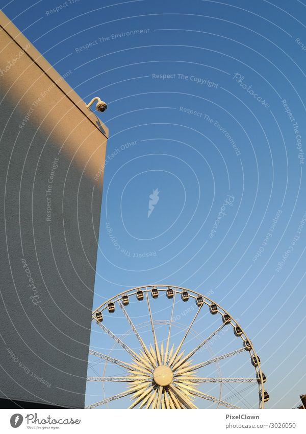 Ferris wheel Lifestyle Style Joy Vacation & Travel Tourism Trip Fairs & Carnivals Town Downtown Tower Manmade structures Architecture Wall (barrier)