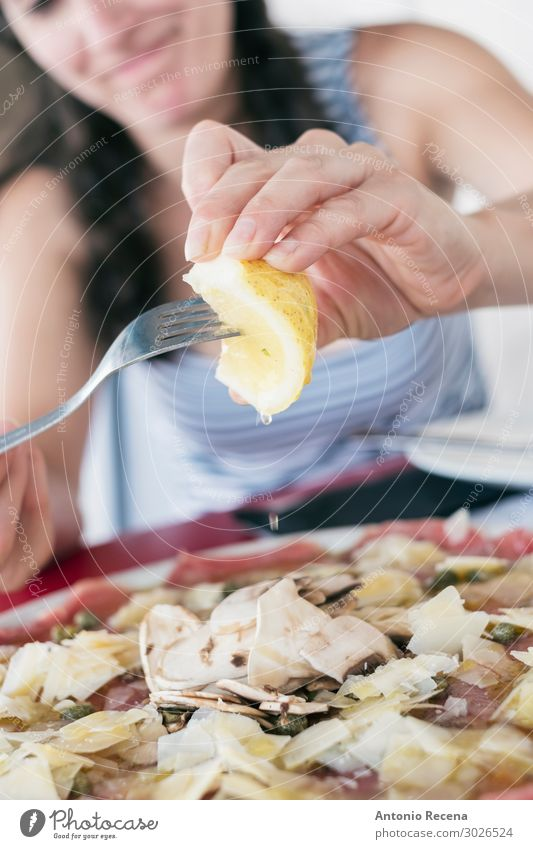 woman eating beef carpaccio in intalian restaurant Meat Juice Fork Lifestyle Restaurant Human being Woman Adults Hand Dress Sunglasses Brunette Good Lemon Beef