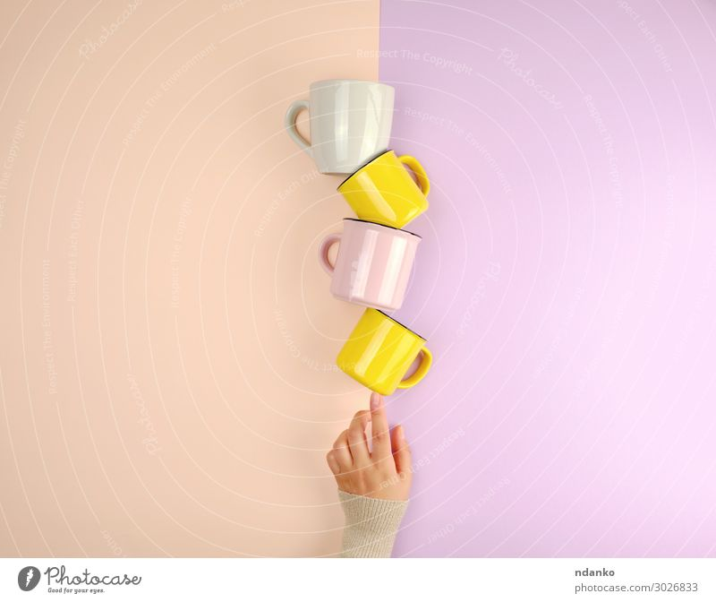 stack ceramic cups Breakfast Beverage Coffee Tea Cup Mug Kitchen Woman Adults Arm Hand Fingers Select Hot Bright Clean Yellow Pink Moody Colour Idea Caucasian
