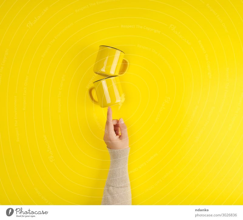 two yellow ceramic cups are supported by a female hand Colour Hand Yellow Bright Arm Fingers Kitchen Coffee Clean Breakfast Hot Tea Cup Stack Hold Set