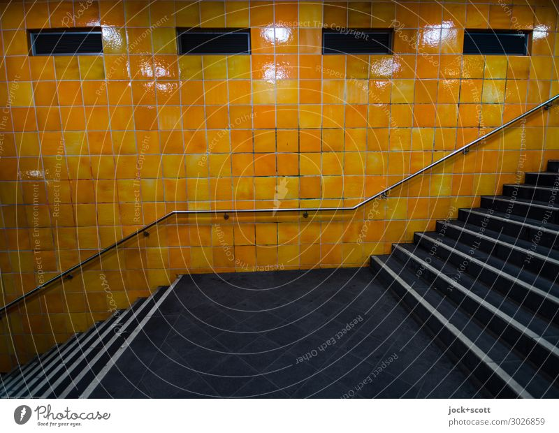 up & down Downtown Berlin Wall (barrier) Wall (building) Stairs Underground Banister Tile Line Authentic Sharp-edged Retro Town Orange Moody Calm Esthetic