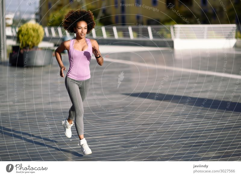 Black woman, afro hairstyle, running outdoors Lifestyle Beautiful Hair and hairstyles Wellness Leisure and hobbies Sports Jogging Human being Feminine