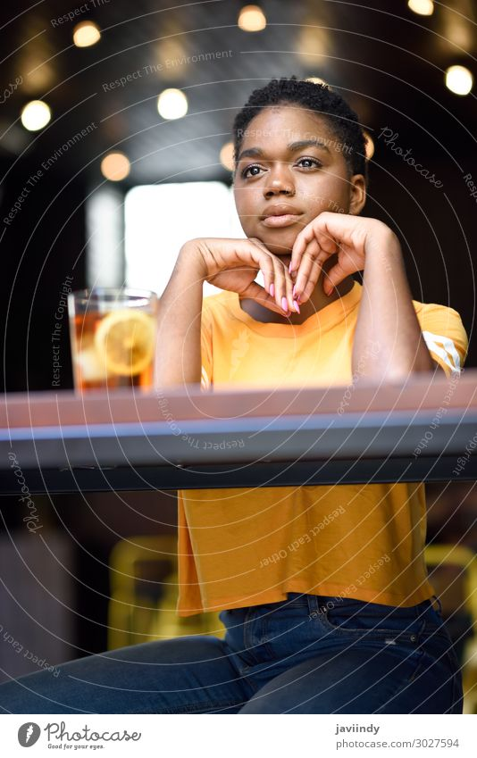 Black woman with very short hair taking a glass of cold tea. Tea Lifestyle Style Happy Beautiful Hair and hairstyles Face Table Restaurant Human being Feminine