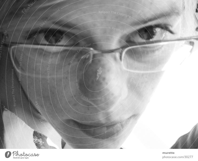 Woman Face Eyes Mouth Nose Eyeglasses 13 - 18 years Young woman Freckles Partially visible Face of a woman Person wearing glasses Portrait photograph